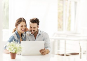 home buyers searching on a laptop